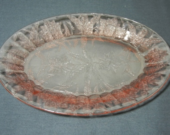 "Floral Poinsettia 10 3/4"" Oval Plate by Jeannette Glass Co."