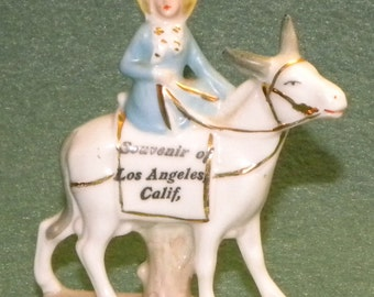 Figurine of Lady Riding on Donkey Souvenir of Los Angeles, Calif