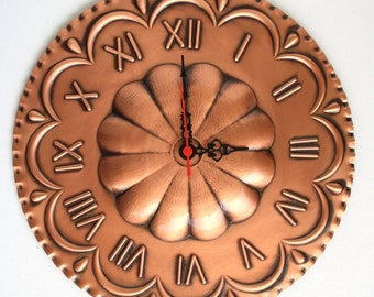 Clock In embossed copper shaped Rosette to hang on the wall.
