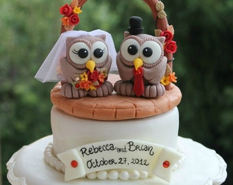 Owl cake topper with wedding arch, brick patio base and banner for names and date, autumn wedding