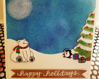Happy holidays with polar bear and penguin