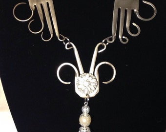 What a statement piece! Very unusual recycled fork necklace