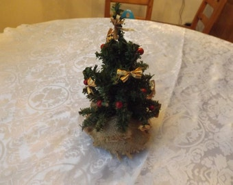 "9.5"" Small artificial Christmas tree."