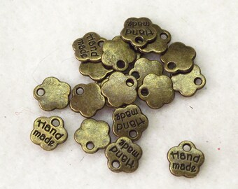 """Antique Bronze """"Hand Made"""" Jewelry Dangles - Package of 25 - 8mm"""
