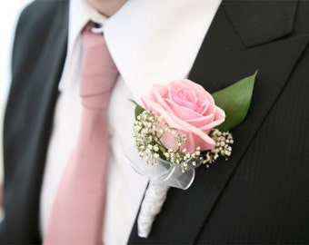 rose boutonniere,bridal accessories,bride flowers