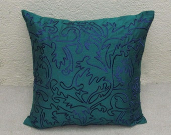 teal green throw pillow cover with blue Moroccan inspired embroidery
