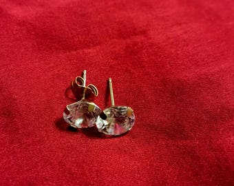 14kt Yellow Gold with 8 mm Crystals. Missing is 1 back to the earrings.