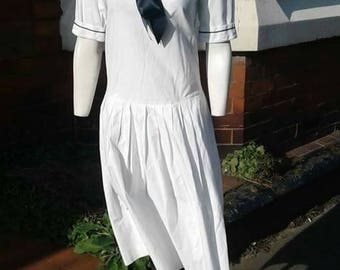 Beautiful iconic 1980s white and navy nautical sailor dress made by Laura Ashley in cotton with big navy ribbon bow