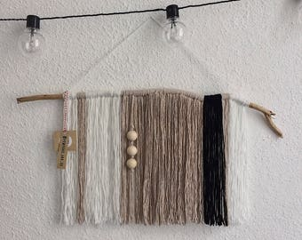 Weaving wall Bohemian spirit with wooden beads