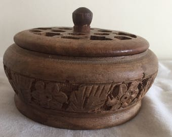 A small, vintage carved wood lidded pot