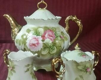 Letfon china tea pot with sugar and creamer set.