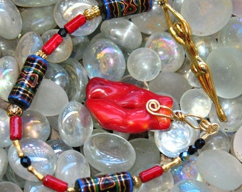 Golden Goddess and Red Coral Pendulum with hand-painted Glass Beads.