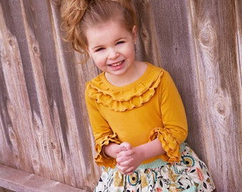 Cheyenne's Ultimate Ruffle Tshirt. PDF sewing pattern for toddler girl sizes 2t - 12.