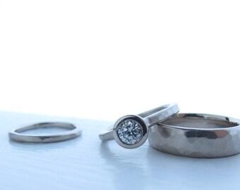 Recycled palladium white gold and diamond wedding set, low profile bezel set diamond engagement ring matching wedding bands The Pebble Set