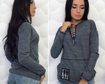 Female gray sweater