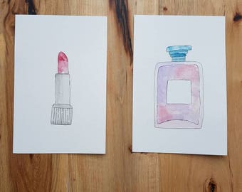 Set of two makeup themed watercolor paintings I gliding a lipstick and a perfume