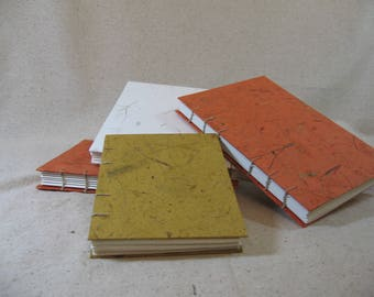 Orange Sketch Journal  (shown here on right).  Item # 2002.