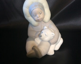 Lladro figurine # 1195 Eskimo Child Playing With A Polar Bear Cub
