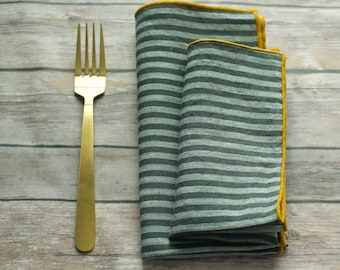 large and small gray and off white striped napkins 100% linen with gold yellow edging