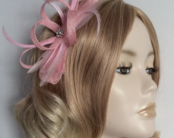 PINK FASCINATOR, Made with sinamay, and Feathers, with crystals, on comb