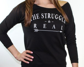 off the shoulder top. graphic tees for women. the struggle is real. slouchy sweatshirt. gym sweatshirt. trendy plus size clothing.
