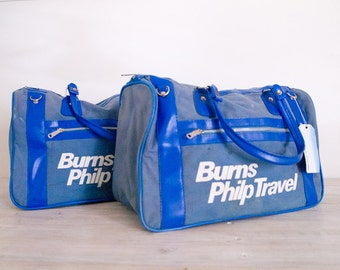 pair of blue burns philp travel travel bags with ansett australia paper tag
