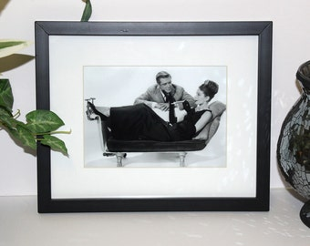 Audrey Hepburn and George Peppard Breakfast At Tiffany's 5x7 photo. Framed and Matted display measures a final size of 8x10.  #4