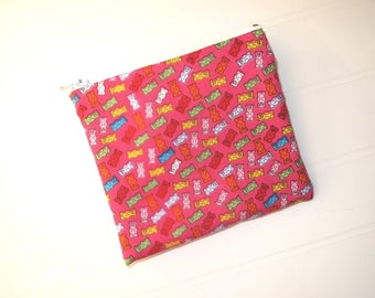 Pink small purse or cosmetic clutch with candy teddies