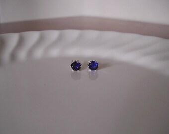 Tiny sapphire stud earrings set in sterling silver; sapphire post earrings; small sapphire earrings silver; september birthstone