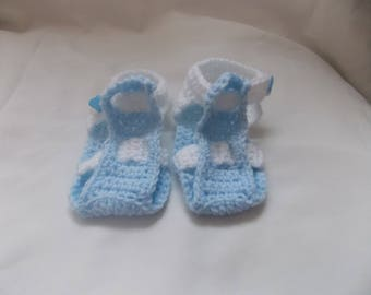 the small blue and white sandals