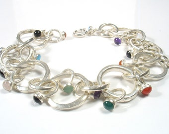 Silver interlocked rings set with semi precious stones, fits all- More than a charm bracelet.