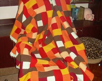 Knitted blanket handmade patchwork technique.