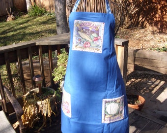 Vegetable garden print, reverse is solid blue with applique and veggie print pockets