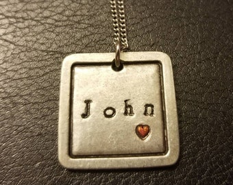Personalized handstamped name necklace.