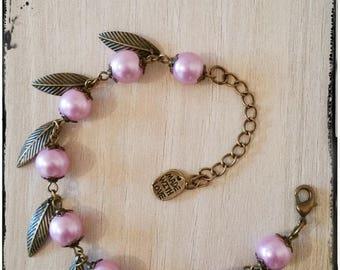 Designer bronze charms and pink beads bracelet