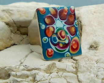 Square blue statement ring on psychedelia and the Blooming SpRing