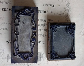 Two antique rubber stamps, ornate frame