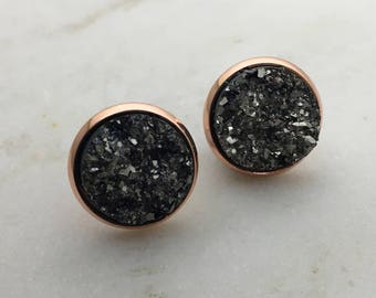 Grey sparkling stud earrings. 14mm rose gold casing with surgical steel and nickel free posts.