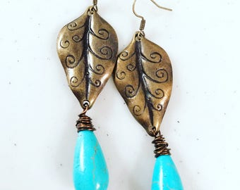 Vintage bronze leaves with wire wrapped turquoise howlite stone drops.