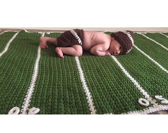 Baby Football Field Blanket only diaper wrap and beanie not included .