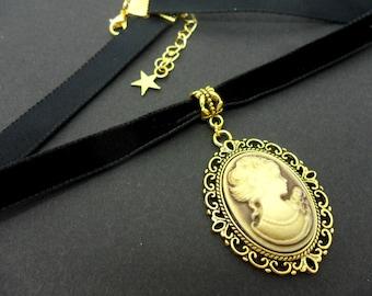 A ladies/girls black velvet & gold colour  10mm (half inch) choker cameo  necklace.