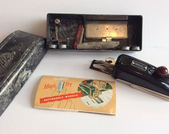 Vintage sewing machine attachment, White Magic Key button hole maker all complete in Bakelite box, VG condition made in the USA, 1950's