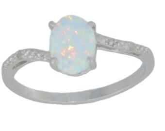 14Kt White Gold Opal & Diamond Oval Ring