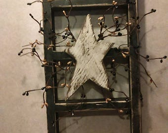 Handsome primitive wooden ladder with wooden star and berries