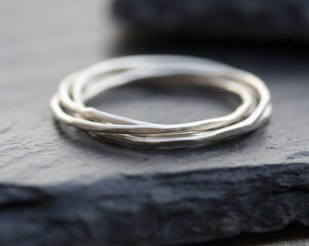 Interlocking ring made of 4 tiny bands, sterling silver, 9k gold