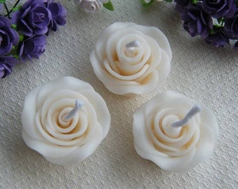 30x small Rose floating candles 3.5cm size