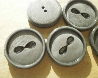 2 buttons with two round holes in plastic, gray, diameter 28 mm