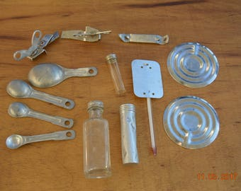 Junk Drawer,Kitchen Decor Lot,Thermometer,3 Can Opener's,Beat up Tin bottle & plastic bottle with lids,Glass Bottle,2 Canning lid's