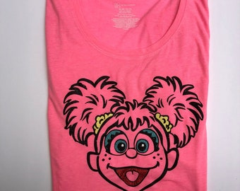 Woman's Pink Fitted Glitter Abby Cadabby Shirt