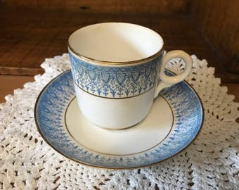 Charming little tea cup and saucer. Robins egg blue. Ruskin english made.